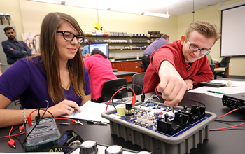 Students working with test equipment in a lab
