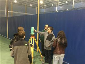 Students using surveying equipment