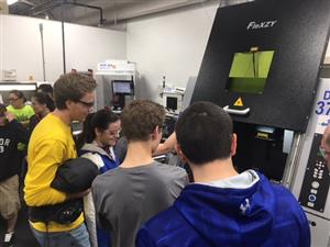 Students learning how a milling machine works